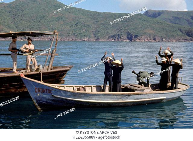 Motorized sampans hunting for Viet Cong weapons, Qui Nhon, Vietnam, 1959-1975
