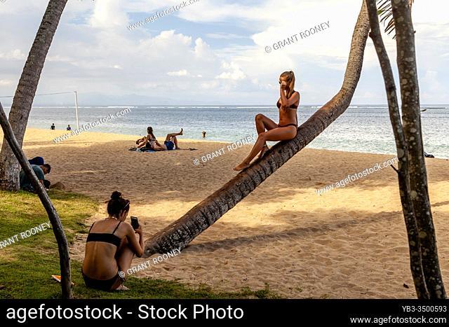 Tourists Taking Photos On Sanur Beach, Bali, Indonesia