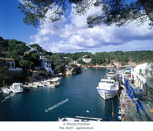Boats in the river under cloudy sky, Mallorca, Balearic Islands, Spain