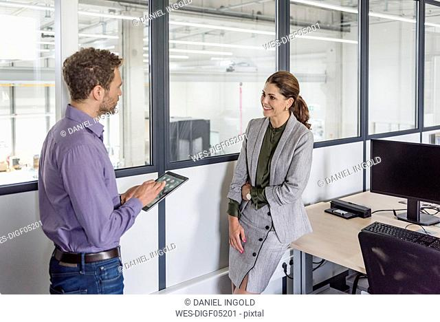 Businessman and woman having a meeting in company office
