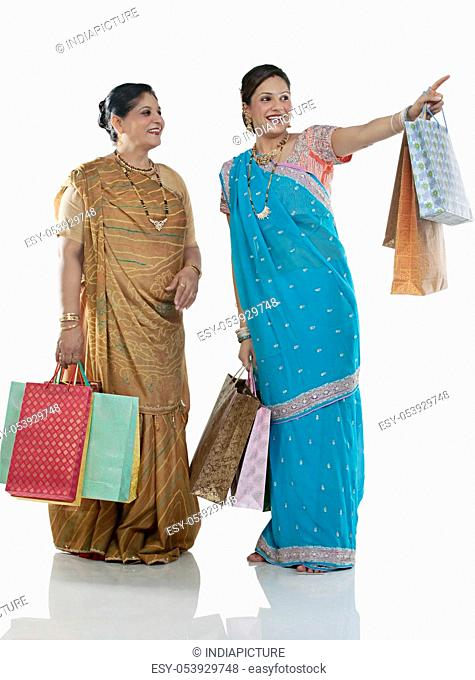 Gujarati mother and daughter with shopping bags