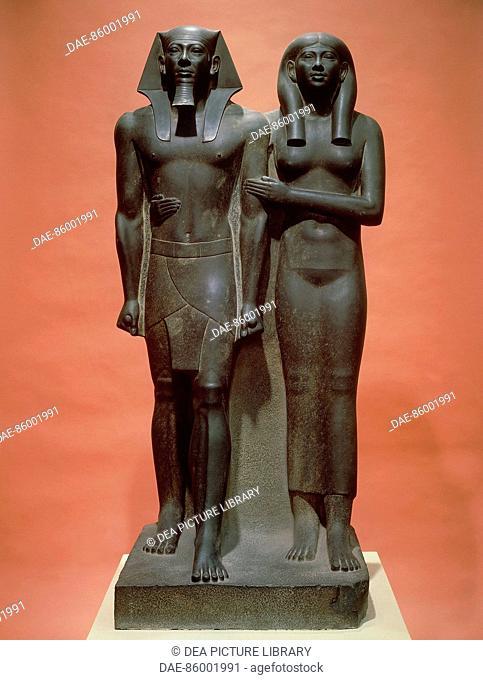 Egyptian civilization, Old Kingdom Dynasty IV. Schist statue depicting Menkaure and his wife Khamerernebty II