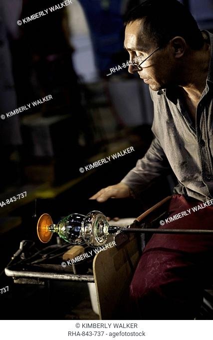 Male glass blower at Moser Glass Factory in various stages of crafting crystal goblets, Karlovy Vary (Karlsbad), Czech Republic, Europe