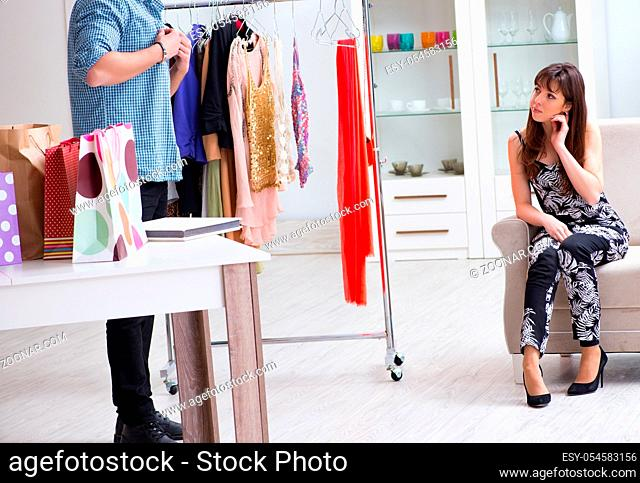 The shop assistant helping woman with buying choice