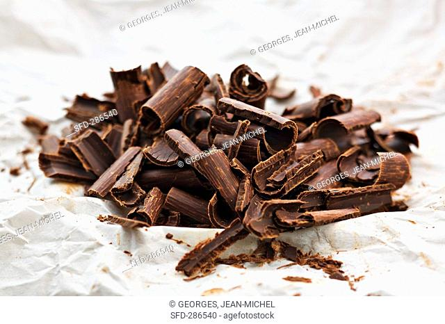 Chocolate curls on paper
