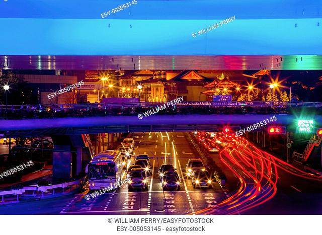 Blue Highway Street Traffic Cars and Light Trails Jingan Temple at Night in Central Shanghai, China