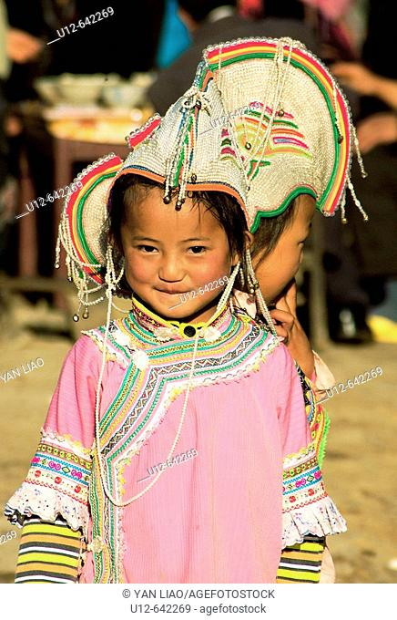 one girl have traditional clothes in the Yuanyang festival , Yunnan , China