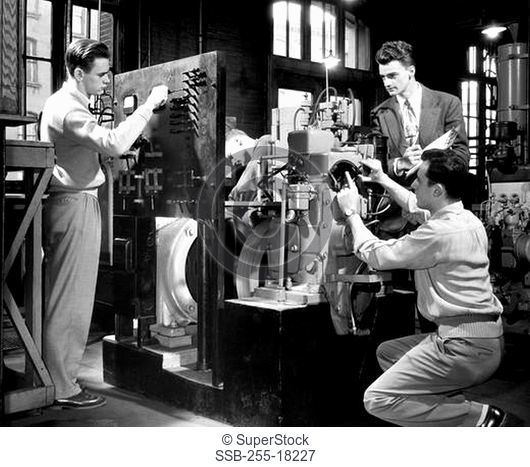 Three college students making a model in a laboratory