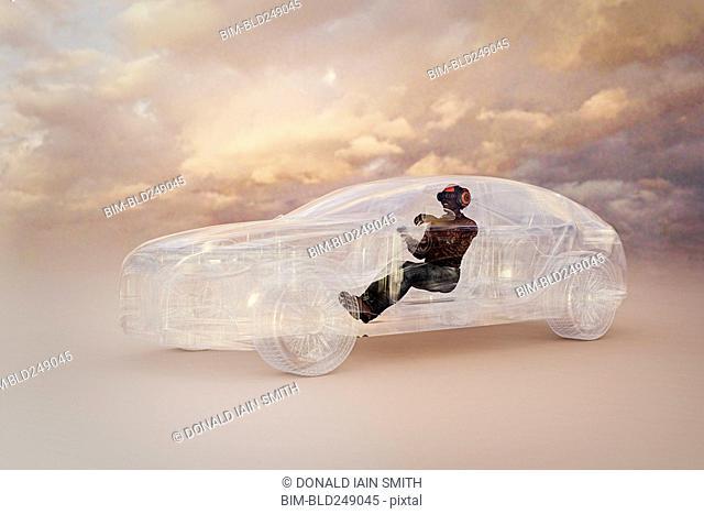 Man wearing virtual reality helmet driving car