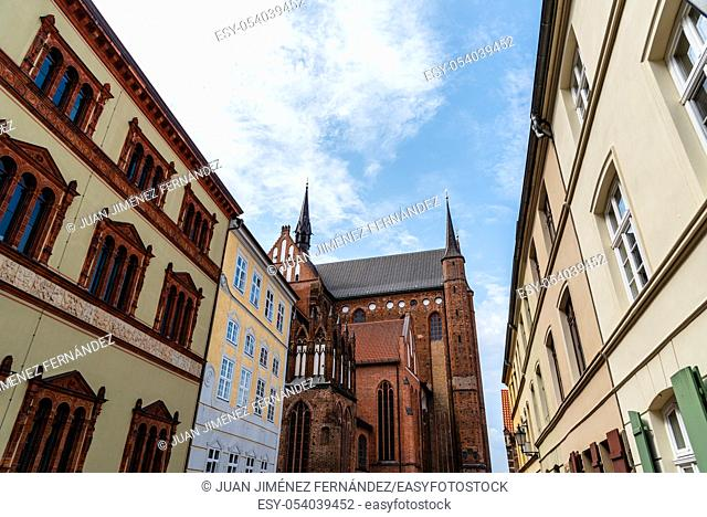 Old houses and St. George church in historic centre of Wismar, Germany