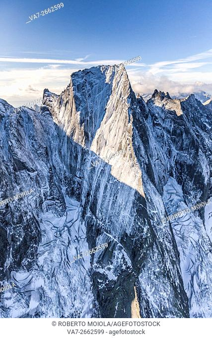 Aerial shot of the north face of Piz Badile located between Masino and Bregaglia Valley border Italy Switzerland Europe