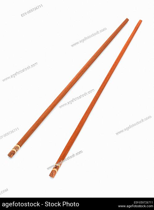 Top view of pair brown chopsticks isolated on white