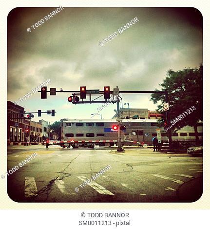 Metra commuter train at rail crossing. LaGrange, Illinois