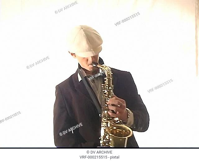 A man plays the saxophone with passion