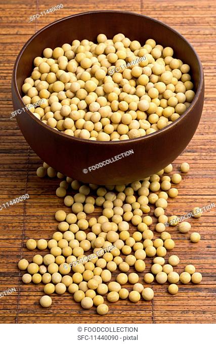 Dried soya beans in a wooden bowl