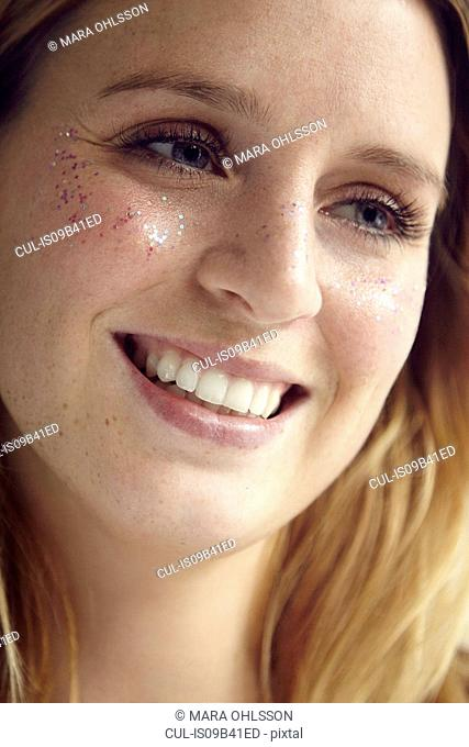 Portrait of woman with glittery face