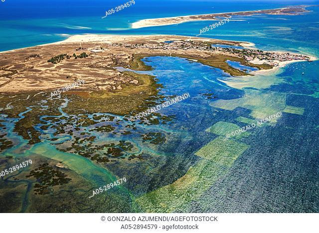 Armona island and Marim canal. Ria Formosa, natural park .In the background Culatra island. Faro district. Algarve. Portugal