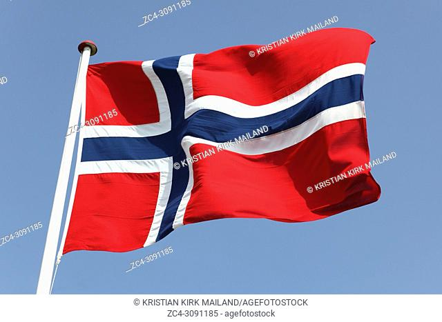 Norway's Flag on flagpole against blue sky