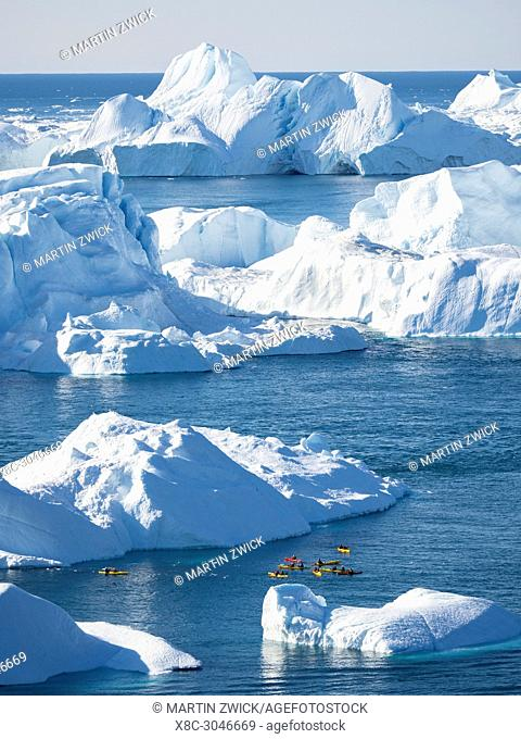 Boat at Ilulissat Icefjord also called kangia or Ilulissat Kangerlua at Disko Bay. The icefjord is listed as UNESCO world heritage