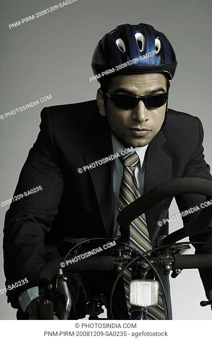Close-up of a businessman cycling