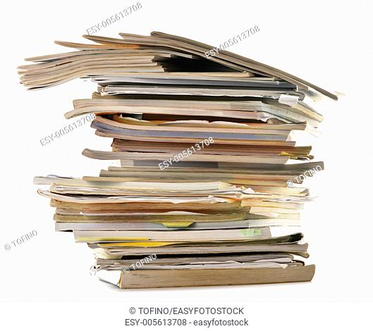Stack of old magazines isolated on white. Paper recycling