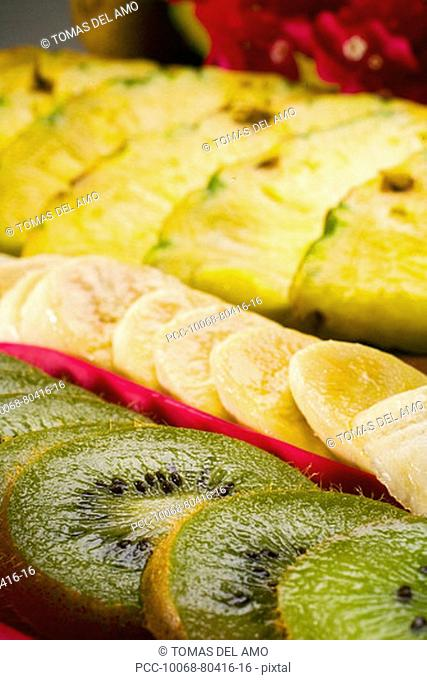 Close-up of kiwi, banana and pineapple slices