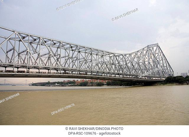 View of Howrah Bridge now Rabindra Setu over River Hooghly ; Calcutta Kolkata ; West Bengal ; India