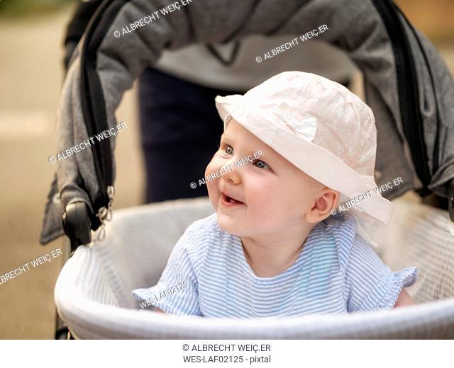 Portrait of relaxed baby girl in pram