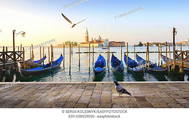 Gondolas and San Giorgio Maggiore island in Venice, Italy