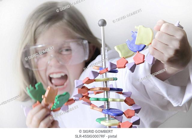 Girl breaking molecular model