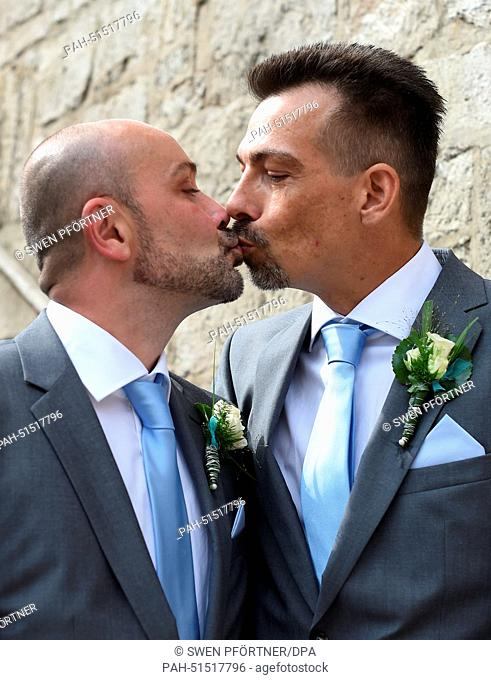 Gay couple Michael (R)and OliverWielsch at the registry office after the civil partnership ceremony in Goettingen, Germany, 29 August 2014