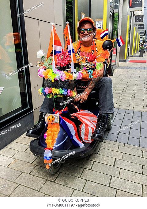 Tilburg, Netherlands. World Championship Soccer 2014. Fan of the Dutch soccer team at the 2014 tournament in Brazil, dressed in orange