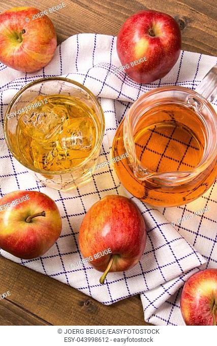 ice cold home made apple juice in a glass with ice cube