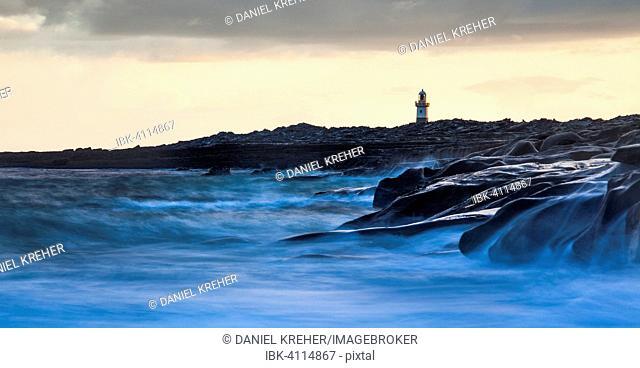 Lighthouse by the coast, high tide, Inis Oirr, Aran Islands, Ireland