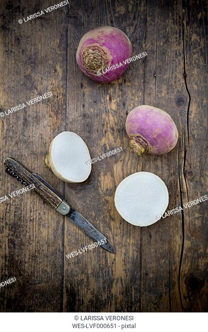 May turnip (Brassica rapa ssp. rapa var. majalis)and knife on wooden table