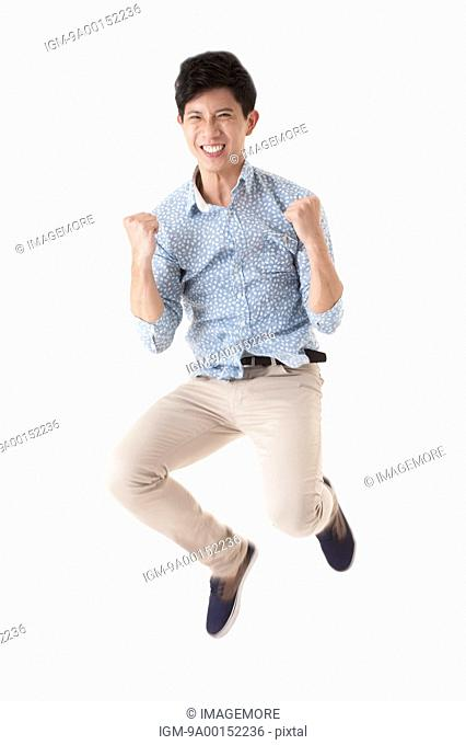 Man jumping in mid-air with smile