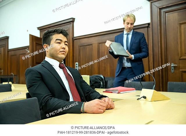 19 December 2018, Bavaria, Nürnberg: Asif N. (l), a refugee from Afghanistan, sits next to his lawyer Michael Brenner in the courtroom of the Nuremberg District...
