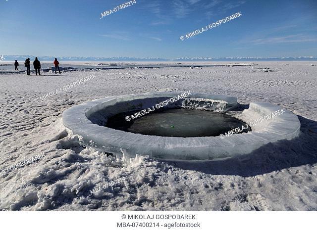 Asia, Russia, Siberia, Buryatia, Irkutsk Oblast, Lake Baikal, Listvyanka, people walking on the ice