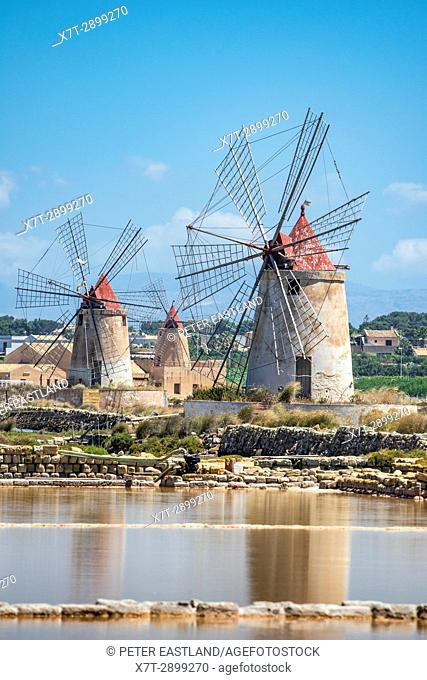 Saltpans and windmills in the Stagnone lagoon between Marsala and Trapani, on the west coast of Sicily, Italy