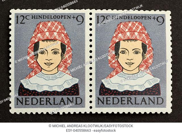 HOLLAND - CIRCA 1950: Stamp printed in the Netherlands shows a picture of a woman in a dutch costume, circa 1950