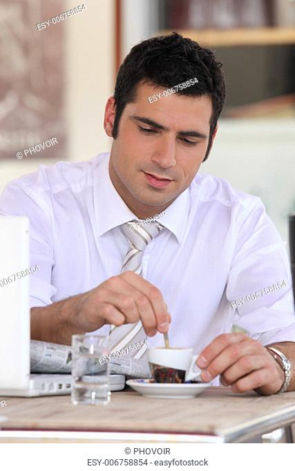 Businessman having an expresso in a cafe