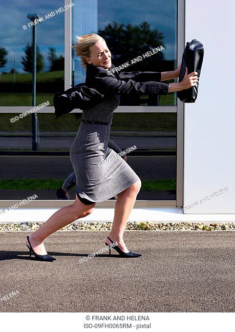 Business woman shielding her face