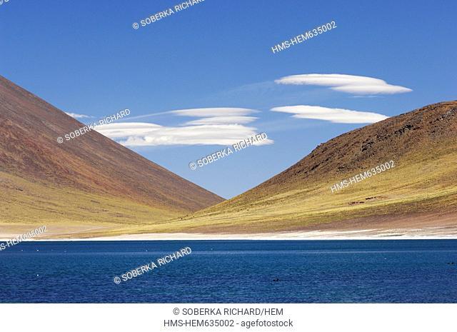 Chili, Antofagasta Region, Altiplano, Los Flamencos National Reserve, Miniques Volcano, clouds altocumulus lenticular above Miscanti Lagoon