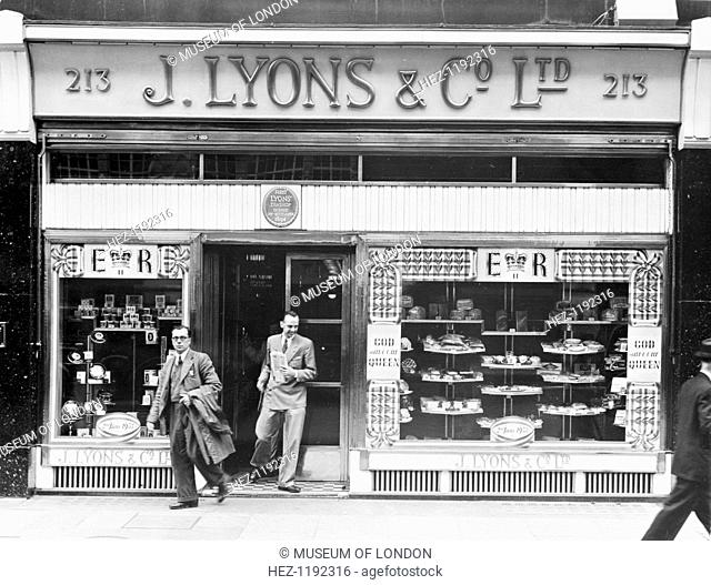 The exterior of a Lyons tea shop along Piccadilly, London, 2nd July 1953. The shop window has been decorated to commemorate the coronation of Queen Elizabeth II