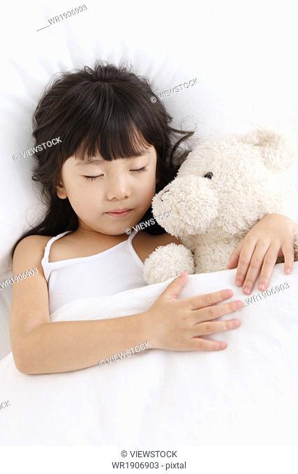 A cute little girl is sleeping
