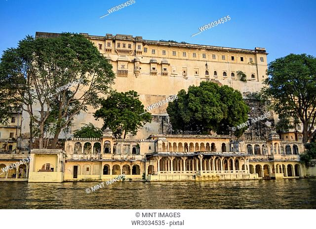 Exterior view of Udaipur City Palace on a hilltop overlooking the lake Pichola