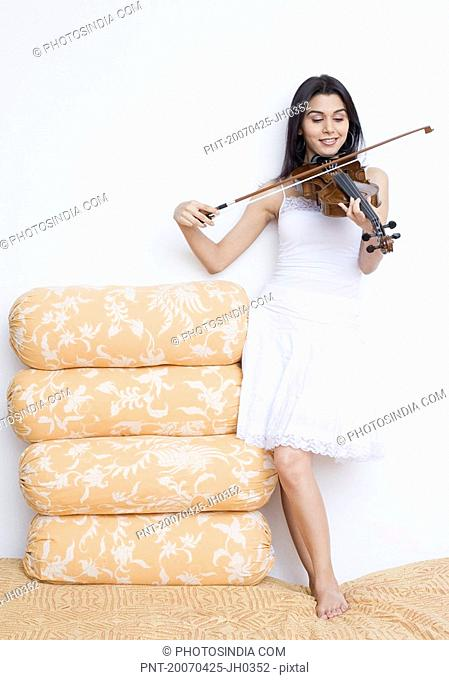 Young woman playing the violin
