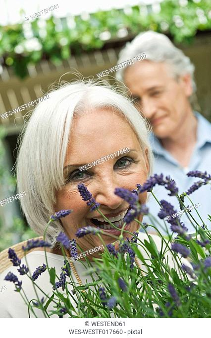 Germany, Bavaria, Man and woman with potted plants