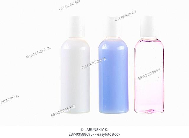 three bottles with cosmetics close-up on a white background isol