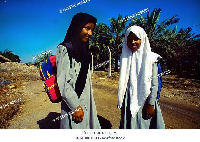 Fujairah UAE Veiled Schoolgirls With Rucksack in Date Palm Oasis